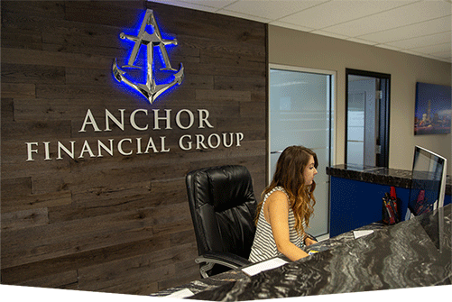 lady receptionist with a background logo of Anchor